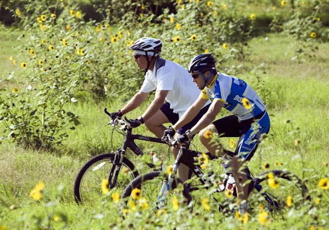 President Bush And Lance Armstrong Take Bike Ride