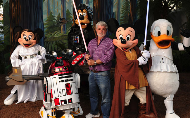 """George Lucas Poses With A Group Of """"Star Wars"""" Inspired Disney Characters At Disney's Hollywood Studios"""