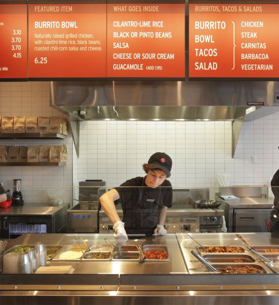 Kyle Braley stirs a tomatillo green chili salsa at Chipotle Mexican Grill in South Portland on Mond