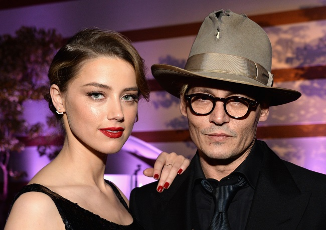 amber-heard-johnny-depp-amazing-hat_getty-resized LOS ANGELES, CA - JANUARY 11: Actors Amber Heard (L) and Johnny Depp attend The Art of Elysium's 7th Annual HEAVEN Gala presented by Mercedes-Benz at Skirball Cultural Center on January 11, 2014 in Los Angeles, California. (Photo by Michael Kovac/Getty Images for Art of Elysium)