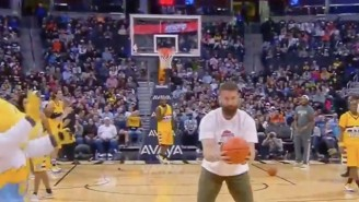 Watch Rockies Outfielder Charlie Blackmon Drill A Backwards Half-Court Shot At the Nuggets Game