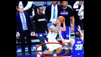 Watch Rajon Rondo Attempt To Kick Deron Williams From The Sidelines
