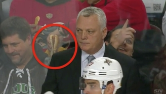 Get A Load Of This Monster Dunking His Hot Dog In Nacho Cheese At A Hockey Game
