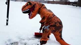 Seeing A Dinosaur Shoveling Snow Proves That Everybody Goes A Little Crazy During A Blizzard