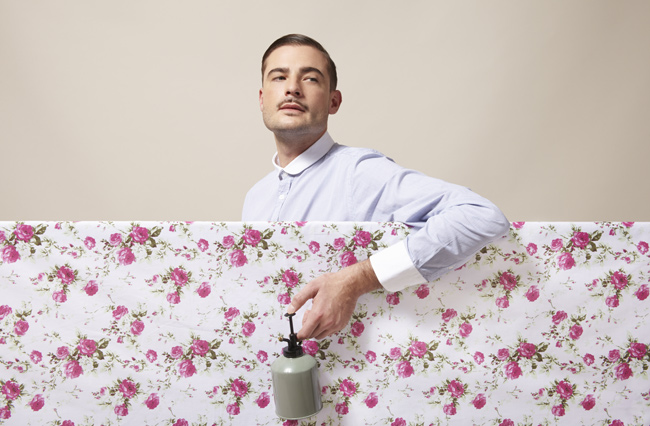 """I searched Getty for """"obnoxious guy"""" and it came back with """"a dapper man spraying flowers on material."""""""