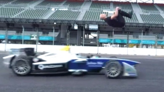 Watch A Crazy Person Do A Blind Backflip Over A Speeding Race Car