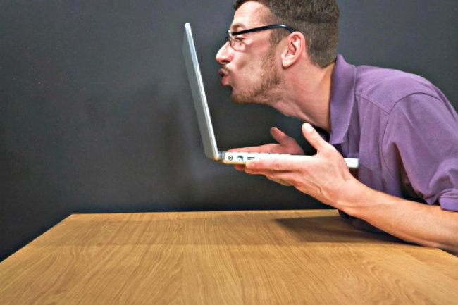 man kissing laptop