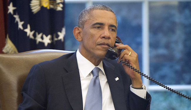 President Obama Works In The Oval Office Of White House
