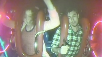 Watch This Dude Freak Out After Passing Out In The Middle Of An Amusement Park Ride
