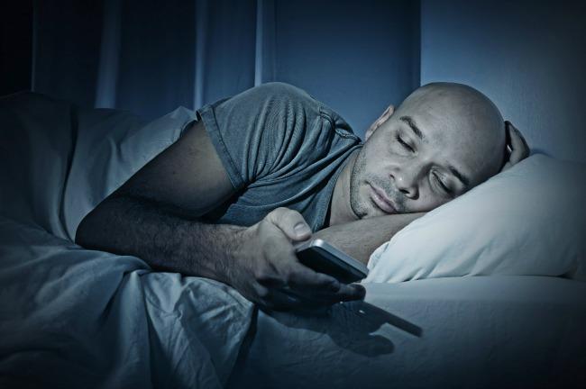 sleeping iphone man