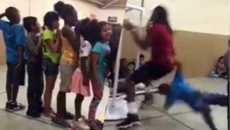 This Poor Child Got A Face Full Of Crotch When A College Basketball Player's Dunk Went Wrong