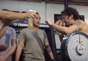 Watch An MMA Fighter Spray Pee At His Opponent During Their Weigh-In