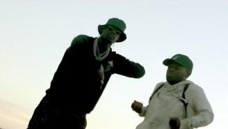 MADEINTYO And Travi$ Scott Bounce Around The Desert For The 'Uber Everywhere (Remix)' Video