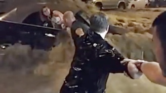 Watch The Harrowing Footage Of A Human Chain Rescuing A Woman Stuck In Her Car On A Flooded Street