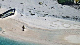 This Cast Away Couple Managed To Find Rescue Thanks To Their Giant S.O.S. On The Beach