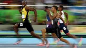 The Already-Iconic Photo Of Usain Bolt Smiling While Winning The 100M Was No Accident