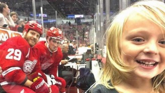 This Young Fan Is 'Famous' After Being Photobombed By Two Red Wings Players From The Penalty Box