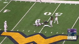 A West Virginia Wide Receiver Made A Backhanded Diving Catch That Seems Virtually Impossible