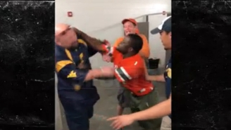 This Miami Fan's Punch-And-Run Didn't Faze A One-Legged West Virginia Fan