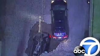 Watch The Moment A Sinkhole Swallows Two Cars As A Result Of California's Deadly Storms