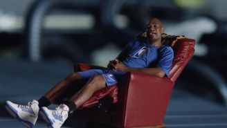 Dikembe Mutombo's Latest Super Weird Ad Campaign Finds Him Living In A Car's Engine