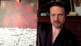 Father John Misty Hams It Up While Unboxing His Intricate 'Pure Comedy' Vinyl Set