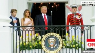 Watch Melania Trump Nudge The President To Raise His Hand For The National Anthem