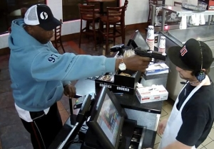 No One Has More Chill Than This Cashier While He's Being Robbed At Gunpoint