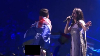 A Guy Draped In An Australian Flag Ran Onto The Eurovision Stage And Mooned Everyone