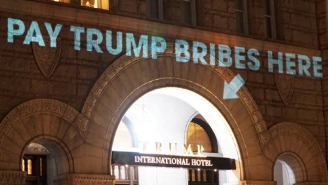 An Artist Takes Trolling Trump To Another Level By Beaming Some Serious Shade Onto His DC Hotel