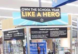 Walmart Apologizes For An Unfortunate Placement Of Their 'Own The School Year Like A Hero' Signage Atop A Gun Case