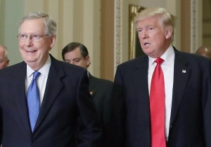 A Protester Threw Several Russian Flags At Donald Trump And Mitch McConnell, But Neither Seems To Notice