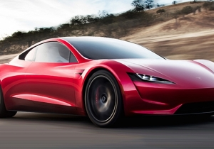 Elon Musk Stokes Tesla Fan's Excitement By Bringing Back The Roadster Alongside Some Shocking Guarantees