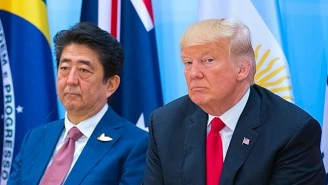 Trump Dumps An Entire Box Of Fish Food At A Koi Pond, But Only After The Japanese PM Does The Same