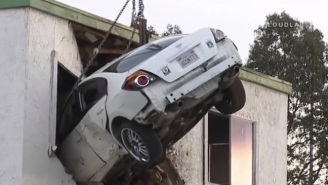 Dramatic Surveillance Footage Shows A Car Going Airborne And Crashing Into A Building's Second Story