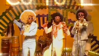 Drake And Migos Don Afro Wigs And Bell-Bottoms For The Satirical 'Walk It Talk It' Video