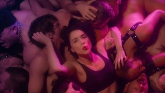 Watch St. Vincent Sweat It Out On The Dance Floor In A Gay Club In Her 'Fast Slow Disco' Video