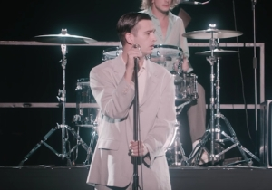 The 1975's 'It's Not Living (If It's Not With You)' Video Is A Paranoid Talking Heads Tribute