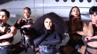Lil Kim Makes A High-Fashion Return To Form In Her Fierce 'Go Awff' Video