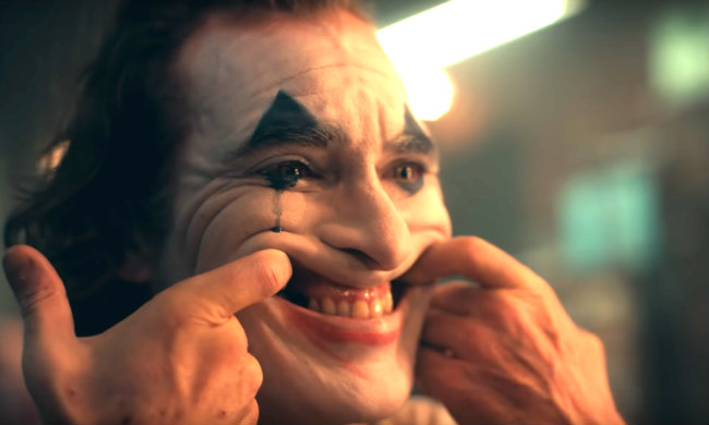 Joaquin Phoenix Puts On A Happy Face As Gotham's Greatest Villain In The 'Joker' Teaser Trailer