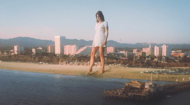 Lana Del Rey Is A Literal Giant In The Video For Her Cover Of Sublime's 'Doin' Time'