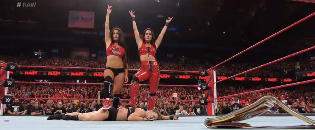 The Bella Twins stand tall over Ronda Rousey