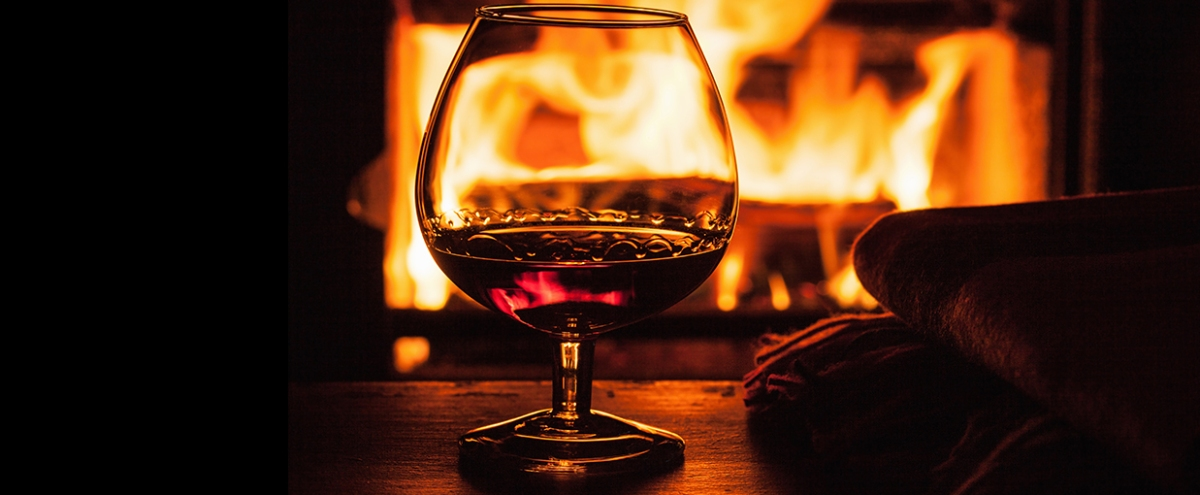The Best Whiskeys To Pair With A Warm Blanket And A Roaring Fire