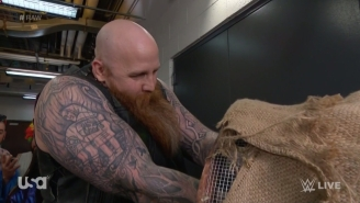 Here's What Was In Erick Rowan's Mysterious Cage On WWE Raw