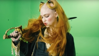 Grimes Invites Fans To Add Their Artistic Spin On One Of Her Visuals By Offering A Green Screen Video