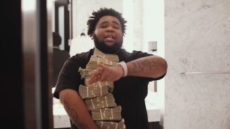 Rod Wave Hugs A Stack Of Money In His Boastful 'Freestyle' Video