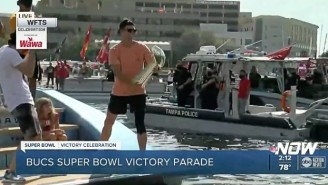 The Bucs' Super Bowl Boat Parade Featured Tom Brady Throwing The Lombardi Trophy