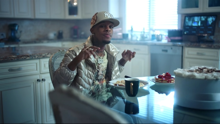 Toosii controls the shortcomings of fame in his 'Does It Cost' video